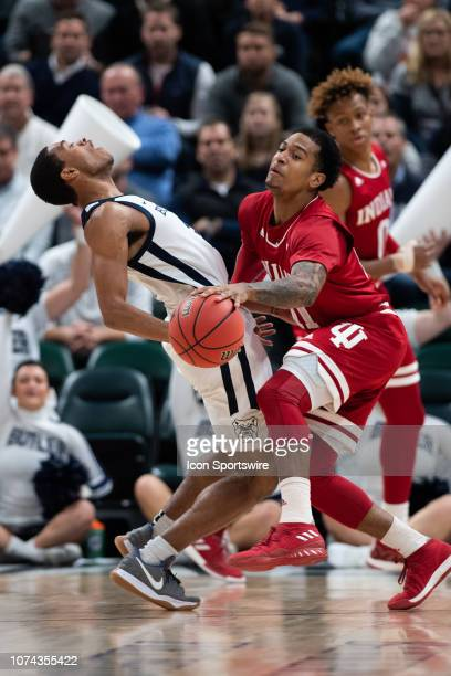 Butler Bulldogs guard AaronThompson takes a charge from Indiana Hoosiers guard Devonte Green during the Crossroads Classic basketball game between...