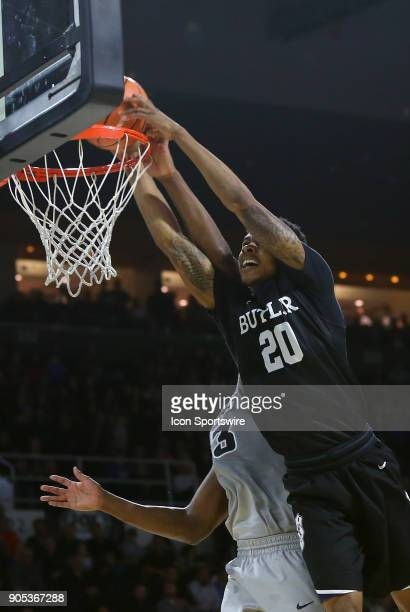 Butler Bulldogs guard Henry Baddley dunks on Providence Friars forward Kalif Young during a college basketball game between Butler Bulldogs and...