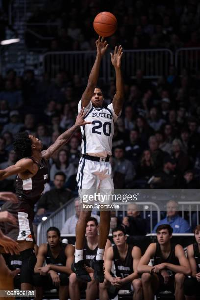 Butler Bulldogs guard HenryBaddley hits a three pointer from the corner during the men's college basketball game between the Butler Bulldogs and...