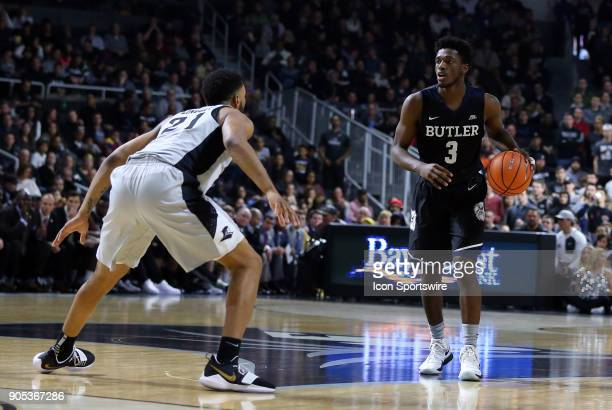 Butler Bulldogs guard Kamar Baldwin defended by Providence Friars guard Jalen Lindsey during a college basketball game between Butler Bulldogs and...