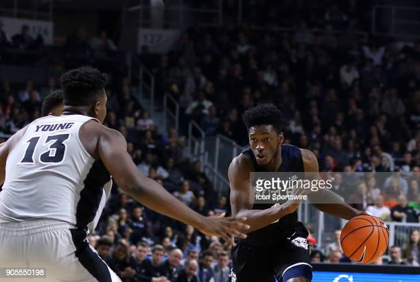 Butler Bulldogs guard Kamar Baldwin defended by Providence Friars forward Kalif Young during a college basketball game between Butler Bulldogs and...