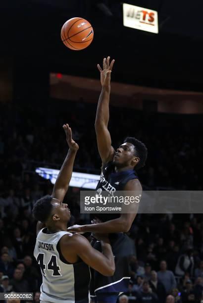 Butler Bulldogs guard Kamar Baldwin shoots over Providence Friars guard Isaiah Jackson during a college basketball game between Butler Bulldogs and...
