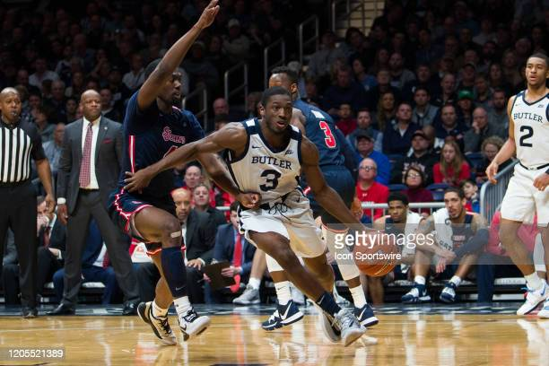 Butler Bulldogs guard KamarBaldwin drives past St. John's Red Storm guard Greg Williams Jr. During the men's college basketball game between the St...