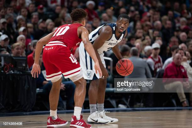 Butler Bulldogs guard Kamar Baldwin looks up at the shot clock as time winds down in the first half during the Crossroads Classic basketball game...