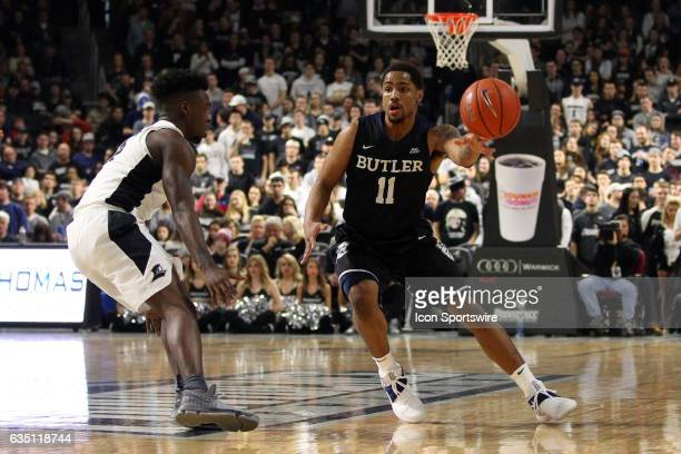 Butler Bulldogs guard Kethan Savage defended by Providence Friars guard Maliek White during the second half of a college basketball game between...