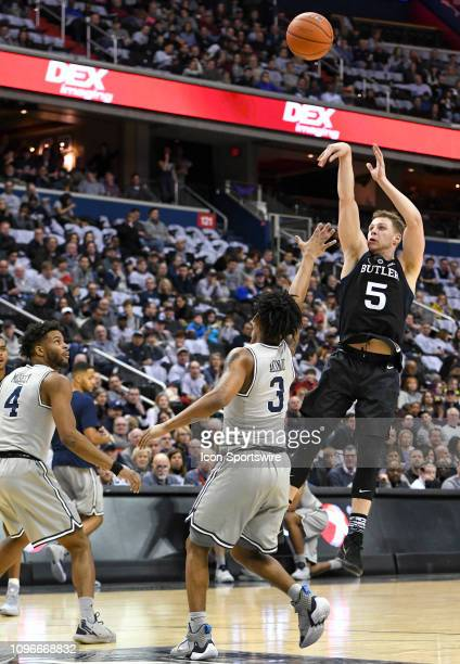 Butler Bulldogs guard Paul Jorgensen scores in the first half against Georgetown Hoyas guard James Akinjo on February 9 at the Capital One Arena in...