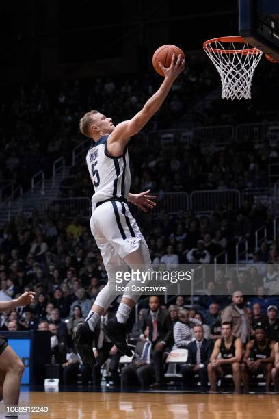 Butler Bulldogs guard PaulJorgensen goes in for a fast break layup after a steal during the men's college basketball game between the Butler...