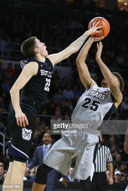 Butler Bulldogs guard Sean McDermott blocks the shot of Providence Friars guard Drew Edwards during a college basketball game between Butler Bulldogs...