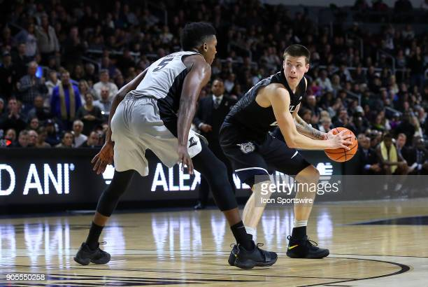 Butler Bulldogs guard Sean McDermott defended by Providence Friars forward Rodney Bullock during a college basketball game between Butler Bulldogs...