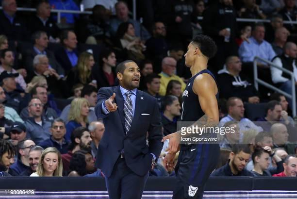 Butler Bulldogs head coach LaVall Jordan speaks with Butler Bulldogs forward Jordan Tucker during a college basketball game between Butler Bulldogs...