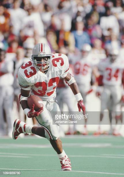 Butler By'not'e Running Back for the Ohio State Buckeyes runs the ball downfield during the NCAA Big Ten Conference college football game against the...