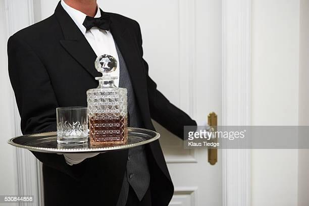 Butler carrying silver platter
