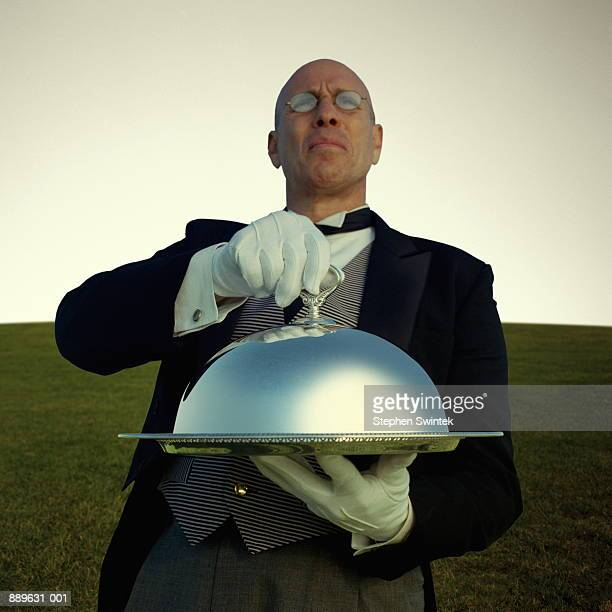 Butler carrying silver platter (Digital Enhancement)