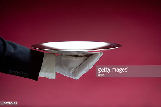 butler holding empty silver tray on red xxl - white glove stock pictures, royalty-free photos & images