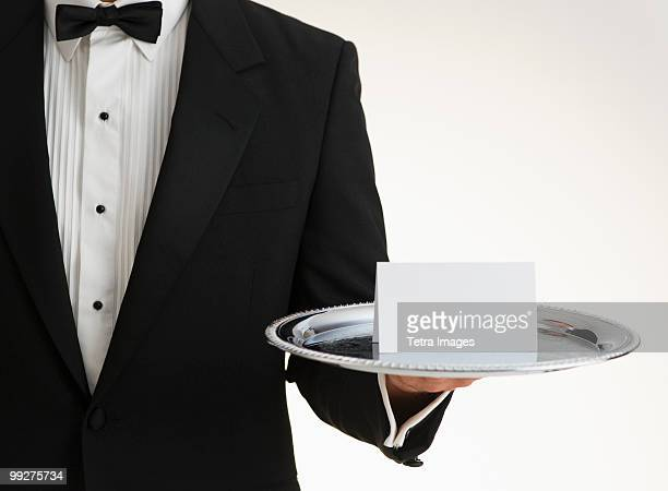 Butler holding silver tray