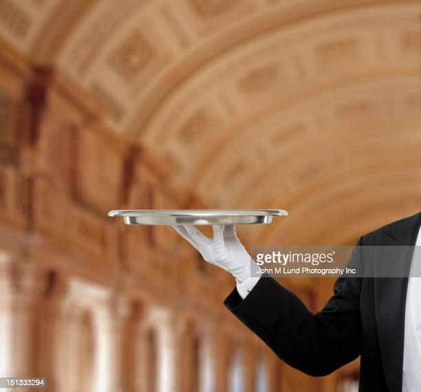 Butler holding tray