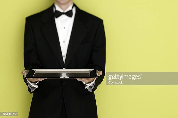 Butler in tuxedo with tray