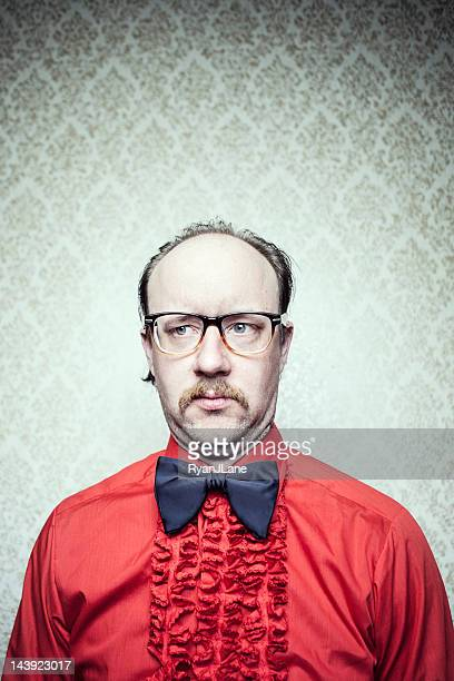 butler man in red frilly shirt & bow tie - frilly stock photos and pictures