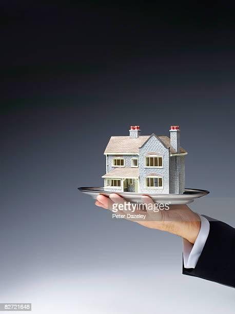 Butler offering house on a platter