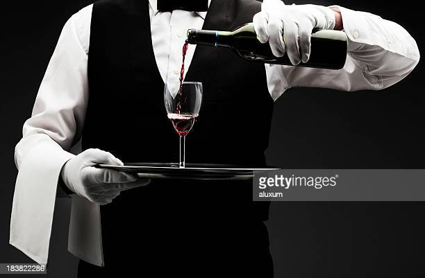 butler pouring wine