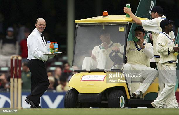 Butler serves drinks during day three of the Johnnie Walker Super Series between Australia and the ICC World XI at the Sydney Cricket Ground October...
