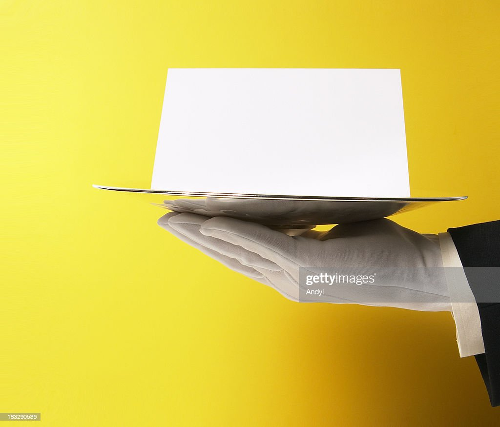 Butler Serving Blank Note on Yellow : Stock Photo