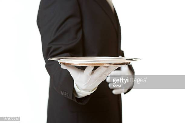 Butler Serving Empty Silver Tray on White