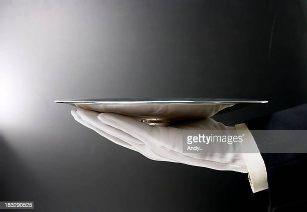 Butler Serving Empty Tray on Black