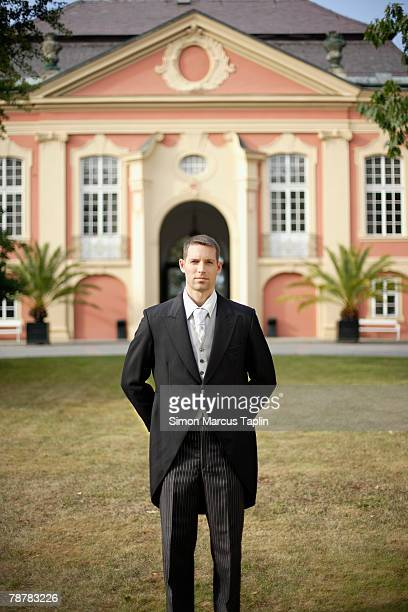 butler standing in front of manor house - tail coat stock pictures, royalty-free photos & images
