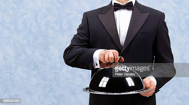 butler waiter revealing - tray stock pictures, royalty-free photos & images