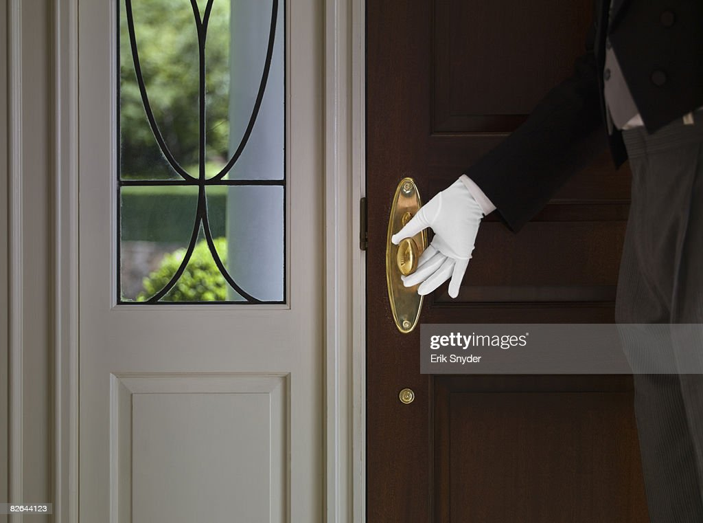 Butler with hand on front door knob. : butler door - pezcame.com