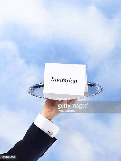 butler with invitation on silver salver - invitation stock pictures, royalty-free photos & images