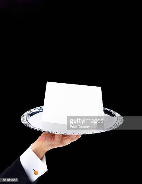 butler with invitation on silver salver - butler stock pictures, royalty-free photos & images