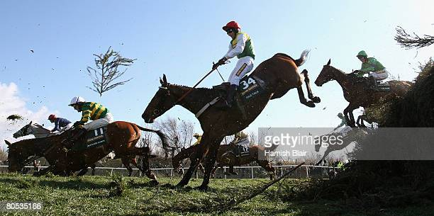 Butler's Cabin ridden by AP McCoy and Idle Talk ridden by Brian Harding come over Becher's Brook during the John Smith's Grand National Steeple Chase...