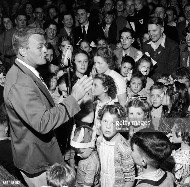 A Butlins Redcoat entertaining families at a Butlins Holiday Camp June 1954
