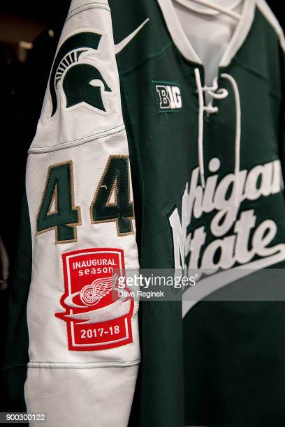 Butrus Ghafari of the Michigan State Spartans jersey with the added patch prior to game one of the Great Lakes Invitational Hockey Tournament against...