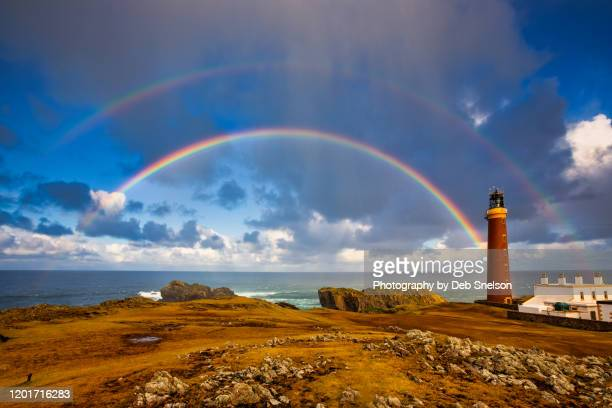 butt of lewis lighthouse and rainbow scotland - season stock pictures, royalty-free photos & images