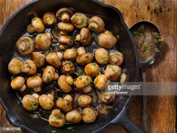 butter and garlic mushrooms with onions - mushrooms stock pictures, royalty-free photos & images