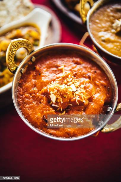 butter chicken curry inside karahi indian serving dishes. north indian food - north indian food stock photos and pictures