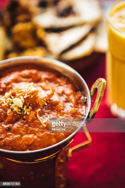 Butter chicken curry inside Karahi Indian Serving Dishes. North Indian food