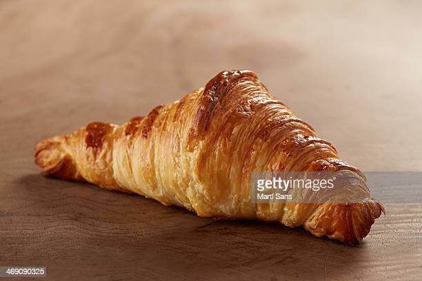 Butter croissant on wooden table