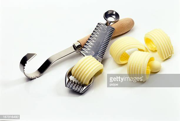 butter knives and decoration curls - margarine stock pictures, royalty-free photos & images