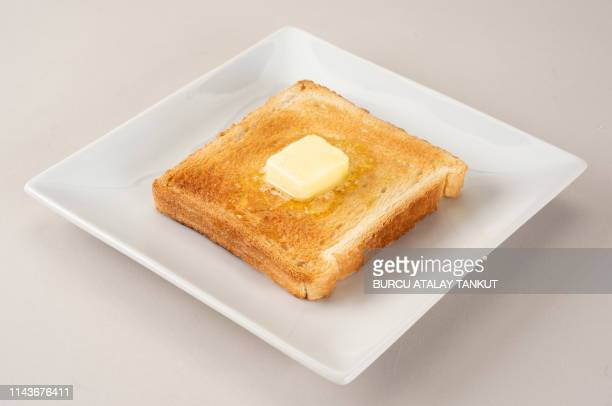 butter on toasted bread - toasted bread stock pictures, royalty-free photos & images