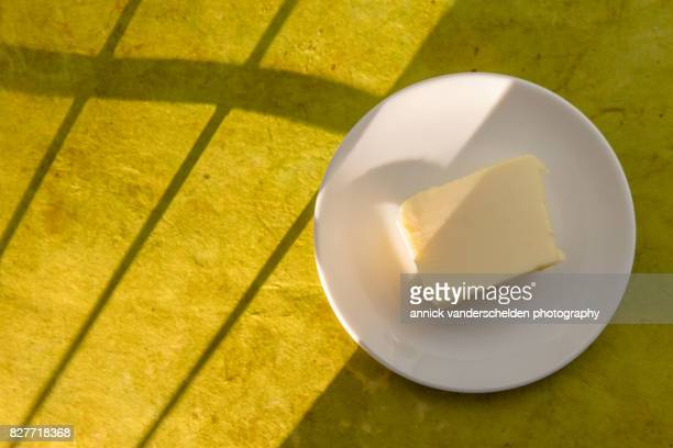 Butter on white plate.