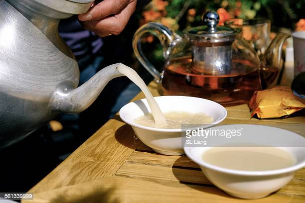butter tea - tibetan culture stock pictures, royalty-free photos & images