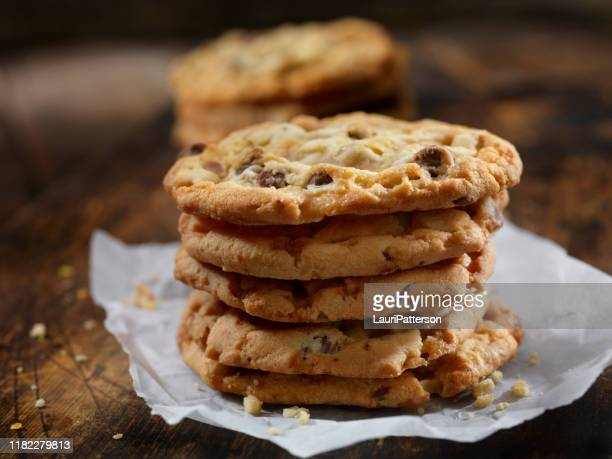 butter toffee crunch chocolate chip cookies - cookie stock pictures, royalty-free photos & images