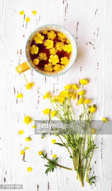 buttercups on white wooden table - buttercup stock pictures, royalty-free photos & images