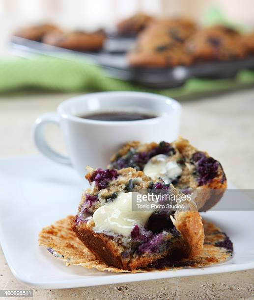 Buttered muffin with coffee