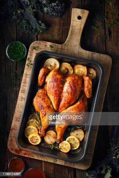 poulet rôti au beurre - poulet grillé photos et images de collection