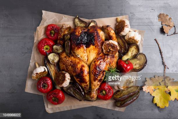 butterflied roast chicken with  seasonal autumn vegetables - roast dinner stock pictures, royalty-free photos & images